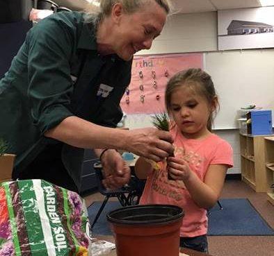 Head Start Student Plants Vegetables